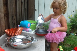 water play in the mud pie kitchen