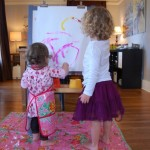 kids painting at the easel
