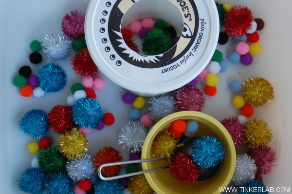 bowl of pom poms for play