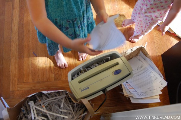 shredding paper in paper shredder with kids