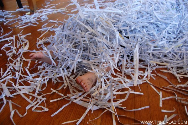 play in shredded paper with kids
