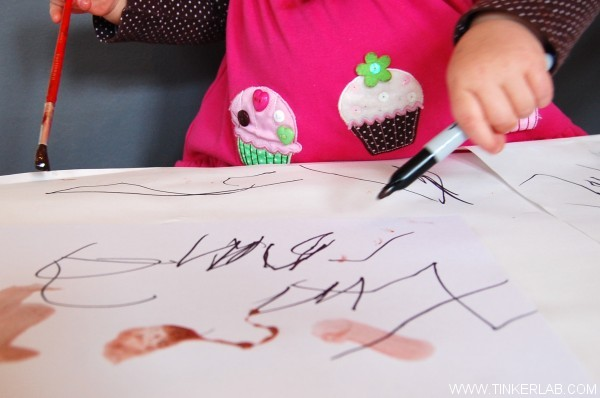 toddler paints with homemade egg tempera paint