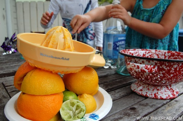 squeezing lemonade with kids