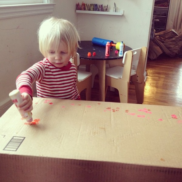 Stamping on a cardboard box from the Tinkerlab Creative Table Project