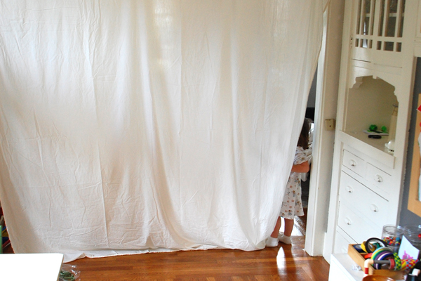 How to build a simple room fort with tape and a sheet