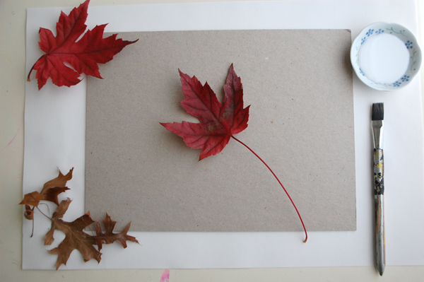leaves and glue on paper