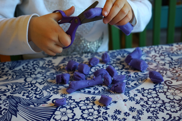 cut play dough with scissors