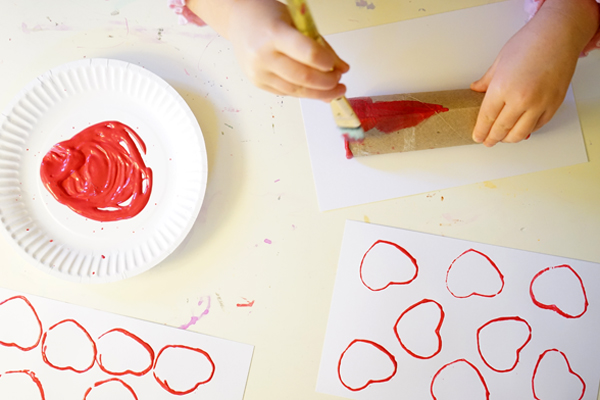 Valentines Craft for Kids | Simple and Colorful Cardboard Roll Heart Stamps with Kids | TinkerLab