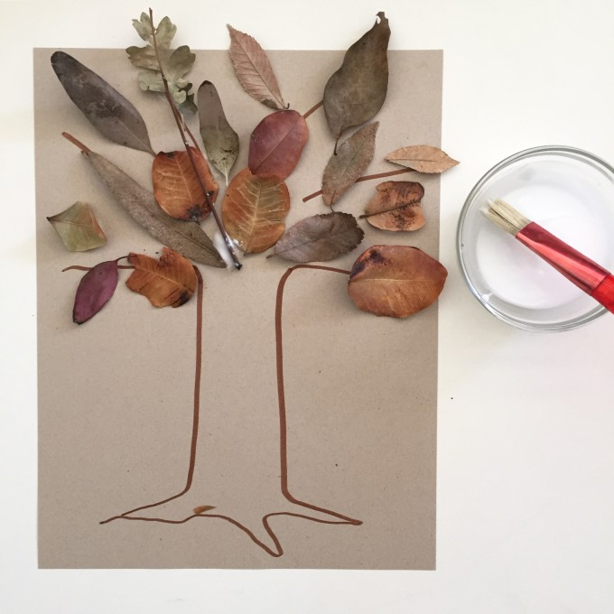 Simple art prompt for kids with leaves, paper, and paper