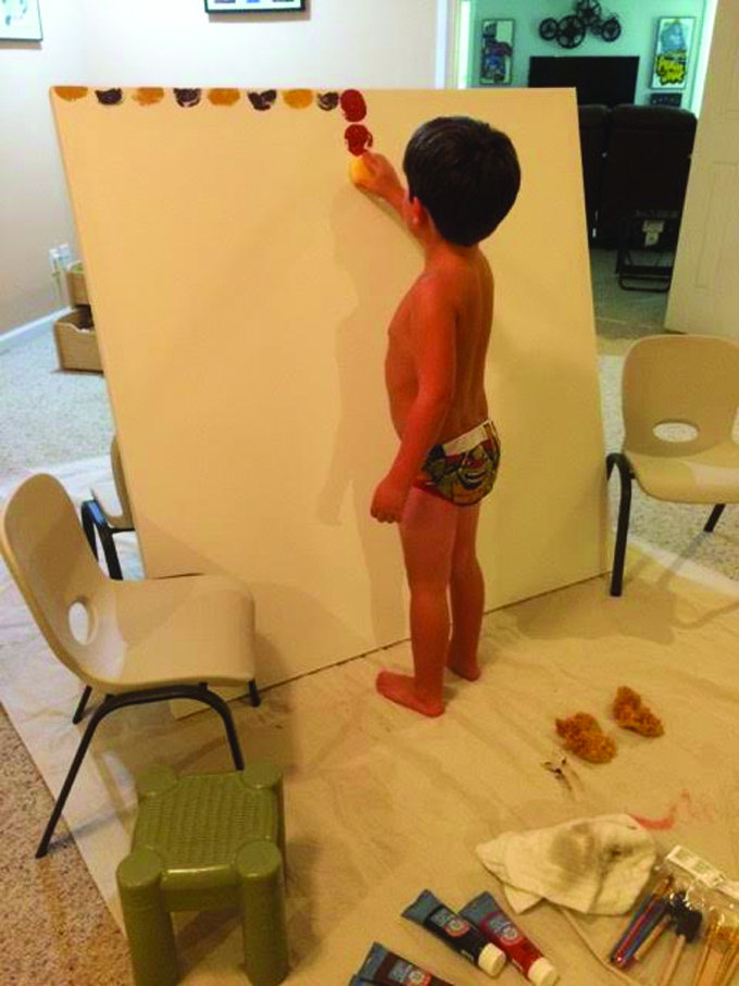 child sponge painting