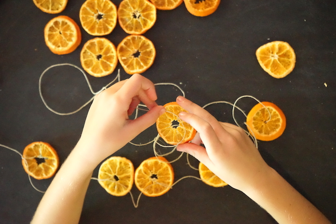 child string orange garland